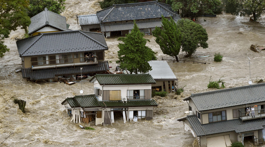 Residents are seen as they wait for rescue helicopters at a residential area flooded by the Kinugawa river, caused by typhoon Etau, in Joso, Ibaraki prefecture, Japan, September 10, 2015. © Kyodo