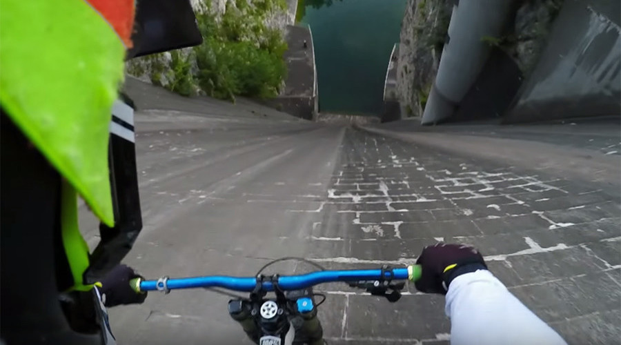 GoPro obsessed: Biker tests limits by riding off dam for prize (VIDEO)