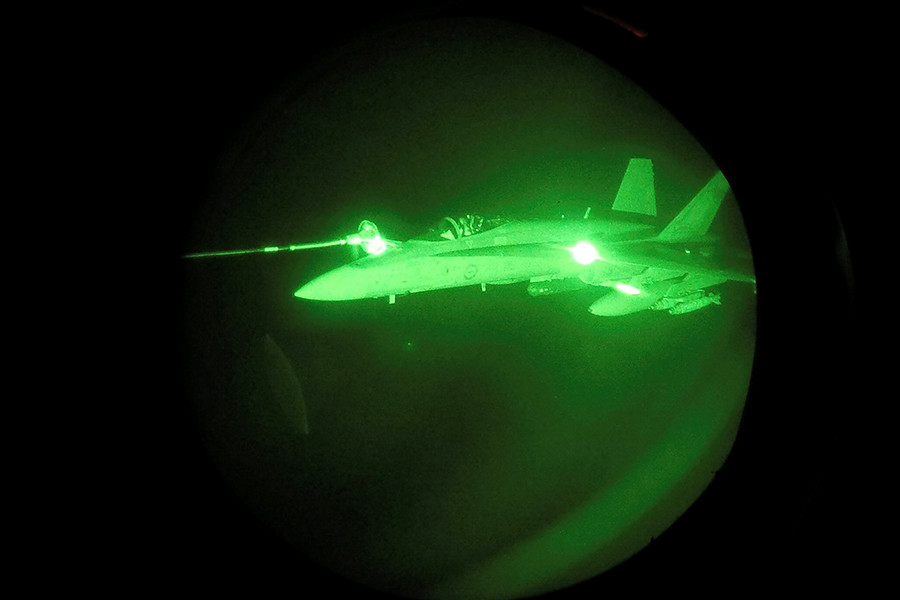 Night Vision image of an F/A-18A Hornet from Australia's Air Task Group refuelling from a Royal Australian Air Force KC-30A Multi Role Tanker Transport aircraft during the first mission of Operation OKRA to be flown over Syria. © defence.gov.au