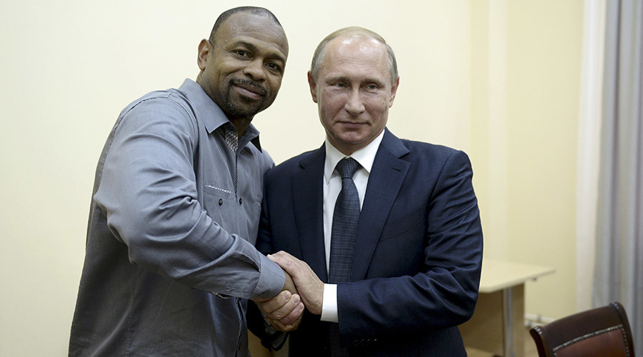 Russian President Vladimir Putin (R) meets with U.S. boxer Roy Jones, Jr. in Sevastopol, Crimea, August 19, 2015. © Aleksey Nikolskyi