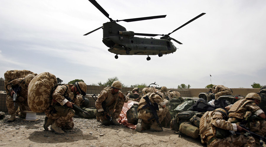 British soldiers take cover as a helicopter lands at Musa Qala in Helmand province, Afghanistan. © Omar Sobhani