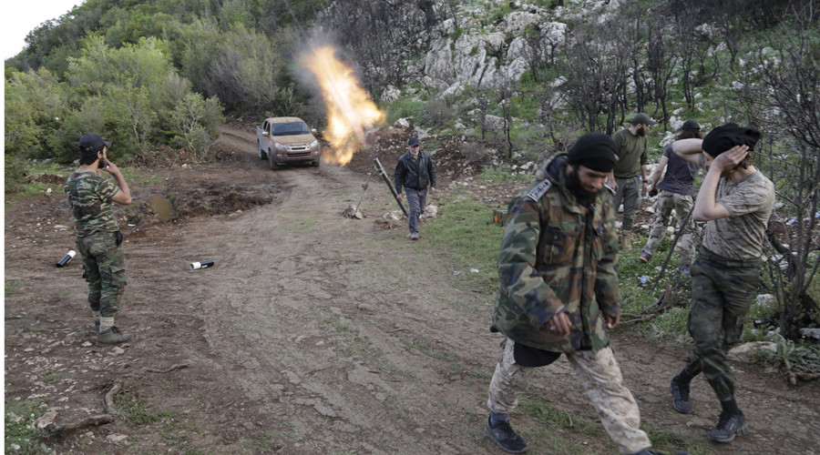 Rebel fighters fire mortar shells at the frontline in the Jabal al-Akrad area in Syria's northwestern Latakia province. © Khalil Ashawi
