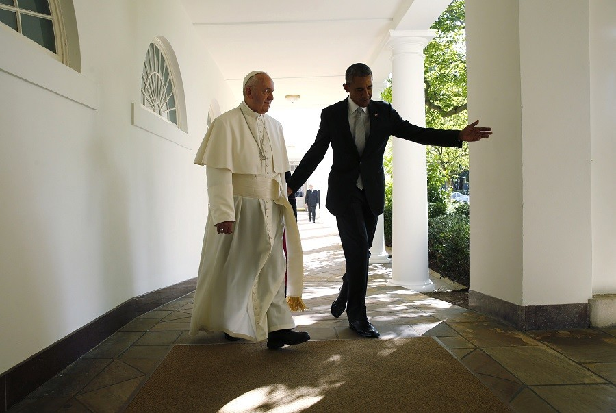 President Barack Obama escorts Pope Francis along the White House colonnade to the Oval Office