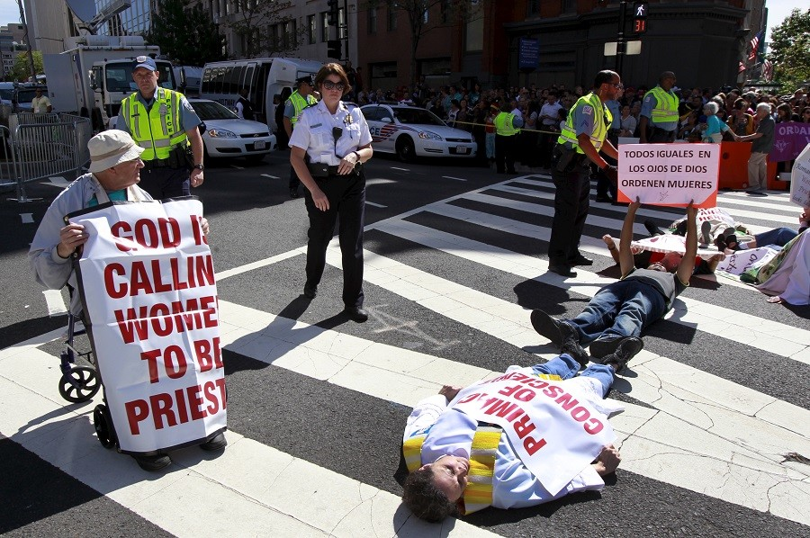 Protesters block a street outside Saint Matthew's Cathedral