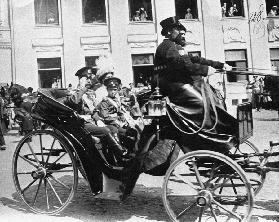 Russian Emperor Nicholas II (left, sitting in the coach) and Empress with son moving along a Moscow street on the day of celebrating the Romanov House 300th anniversary. © RIA Novosti