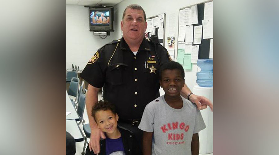'He's like a friend to me': Cop spends own money on hotel, shoes, food for homeless family