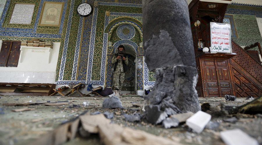A Houthi militant stands inside the al-Balili mosque after two bombings hit the mosque in Yemen's capital Sanaa September 24, 2015. © Khaled Abdullah