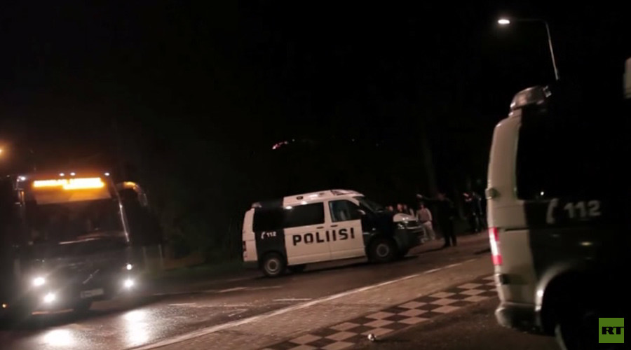Rocks, fireworks, KKK outfit: Finland protesters attack bus with refugees (VIDEO)