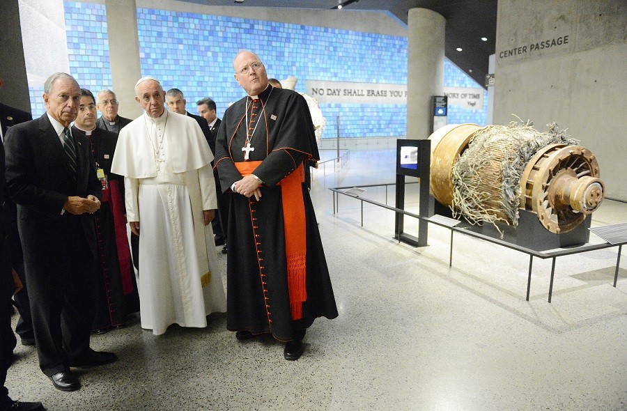 Former NYC Mayor Michael Bloomberg and Cardinal Timothy Dolan escort Pope Francis through the 9/11 Memorial & Museum © Susan Watts