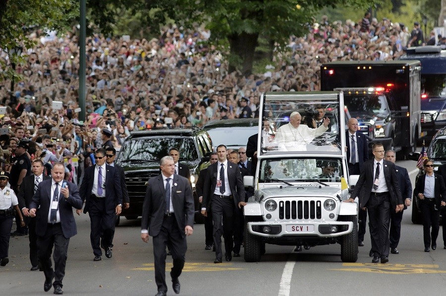 Pope Francis rides in a motorcade in New York's Central Park