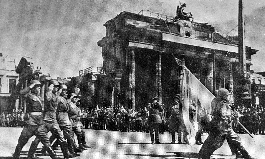 Parade of Soviet troops in Berlin on the Victory Day. The Great Patriotic War of 1941-1945. Reproduction. 1945.