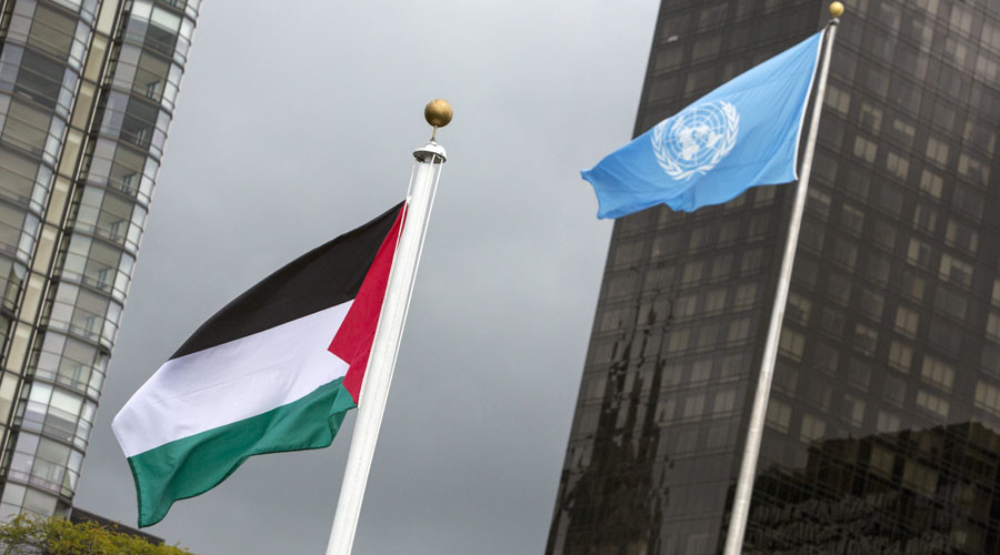 The Palestinian flag flies beside the flag of the United Nations after being raised by Palestinian President Mahmoud Abbas in a ceremony during the United Nations General Assembly. © Andrew Kelly