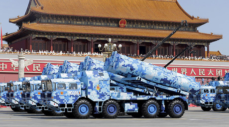 Military vehicles carrying shore-to-ship missiles drive past the Tiananmen Gate during a military parade to mark the 70th anniversary of the end of World War Two, in Beijing, China, September 3, 2015 © Str