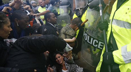 Protestors scuffle with police during a protest at the Ferguson Police Department in Ferguson, Missouri, October 13, 2014. © Jim Young
