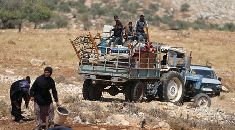Palestinians ride a truck loaded with their belongings after their shanty was demolished by the Israeli army east of the West Bank city of Ramallah © Mohamad Torokman
