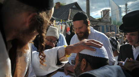 Hasid pilgrims, arrived in the city of Uman to celebrate Jewish New Year Rosh Hashanah, during a prayer. © Pavel Palamarchuk