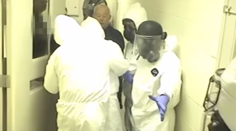 Still from the video showing Fairfax County deputies in full biohazard gear restraining Natasha McKenna on February 3, 2015 © FairfaxCountySheriff