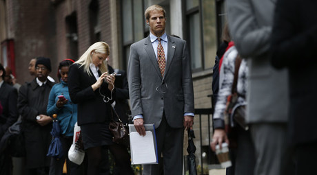 Job seekers stand in line to meet with prospective employers at a career fair in New York City. © Mike Segar