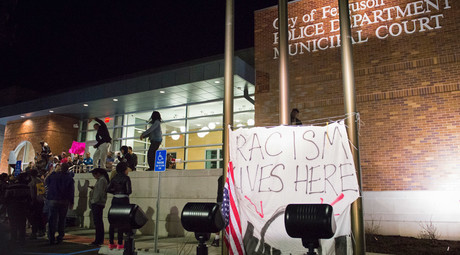 Protestors chant on the steps of the City of Ferguson Police Department and Municipal Court in Ferguson Missouri, March 11, 2015. © Kate Munsch