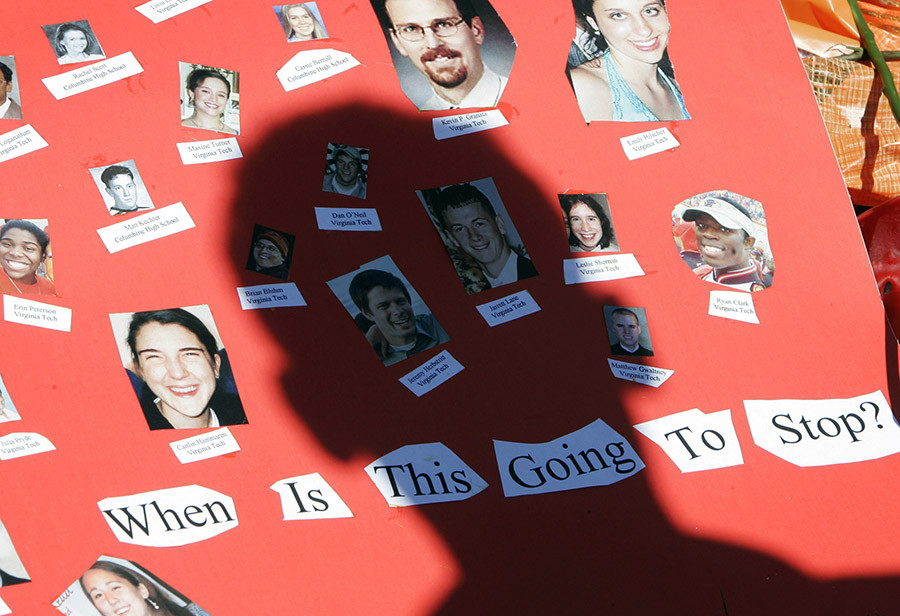 A poster with photos of the victims killed in the Virginia Tech shootings at a memorial on campus © Rick Wilking