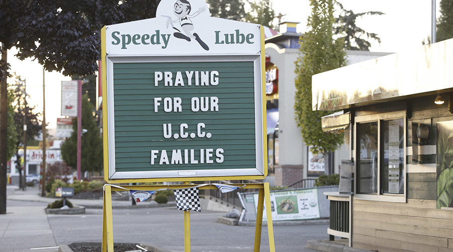 A sign expresses local people's sentiments following a mass shooting at Umpqua Community College in Roseburg, Oregon October 1, 2015. © Steve Dipaola
