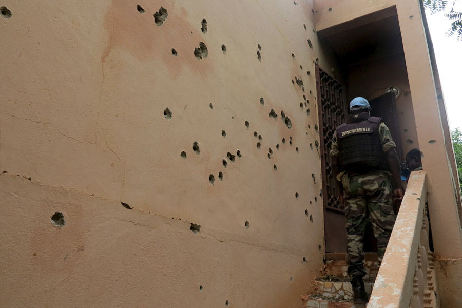A Malian gendarme climbs stairs at the Byblos hotel, site of a siege over the weekend in which 17 people died in Sevare, Mali, August 11, 2015. © Adama Diarra