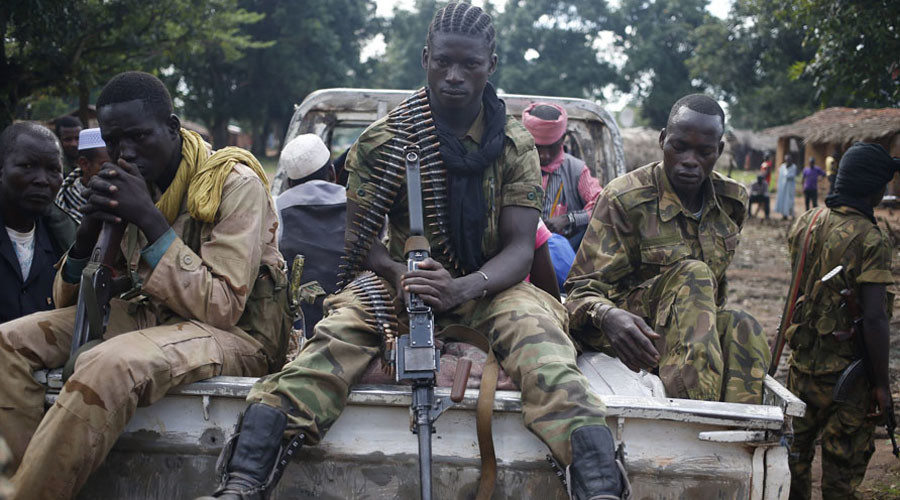 Seleka fighters take a break as they sit on a pick-up truck in the town of Goya June 11, 2014.  © Goran Tomasevic