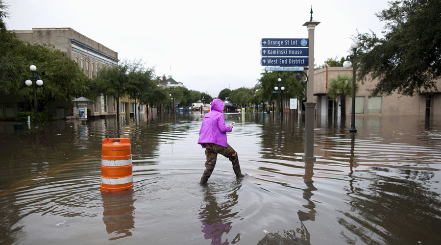 Mary Baldrick of Isle of Palms, South Carolina, wades through flooded Front Street in Georgetown, South Carolina October 4, 2015. © Randall Hill