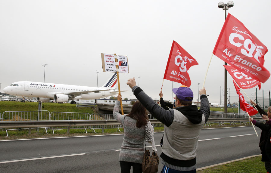 Striking employees of Air France demonstrate in front of the Air France headquarters building at the Charles de Gaulle International Airport in Roissy, near Paris, France, October 5, 2015. © Jacky Naegelen
