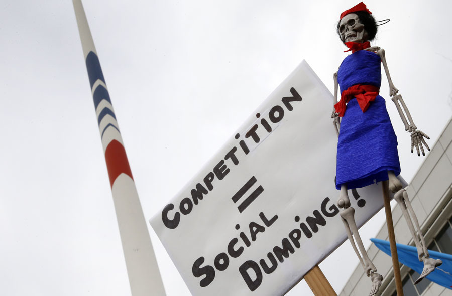 A skeleton doll with a stewardess costume is seen during a demonstration by striking employees of Air France in front of the Air France headquarters building at the Charles de Gaulle International Airport in Roissy, near Paris, France, October 5, 2015. © Jacky Naegelen
