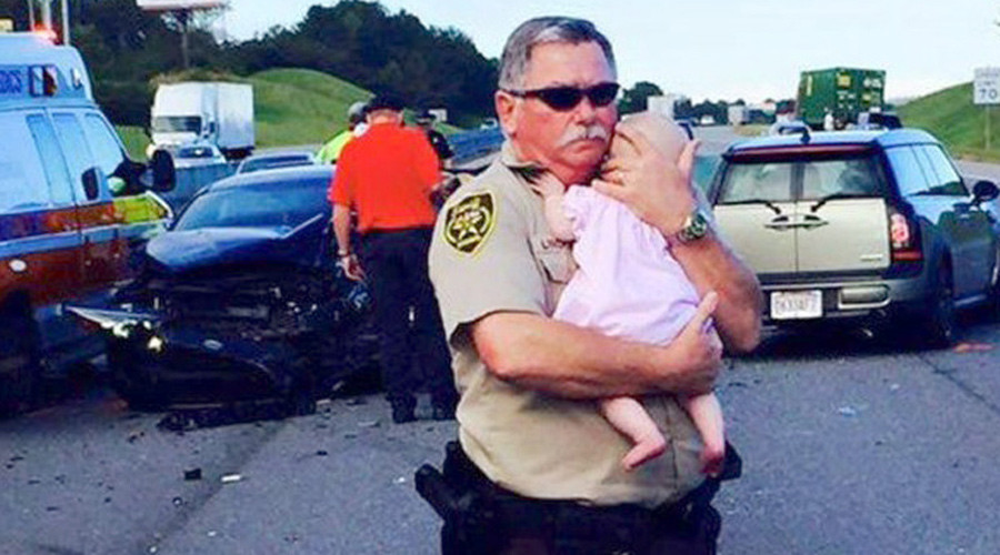 Deputy comforts baby at scene of car crash, photo goes viral
