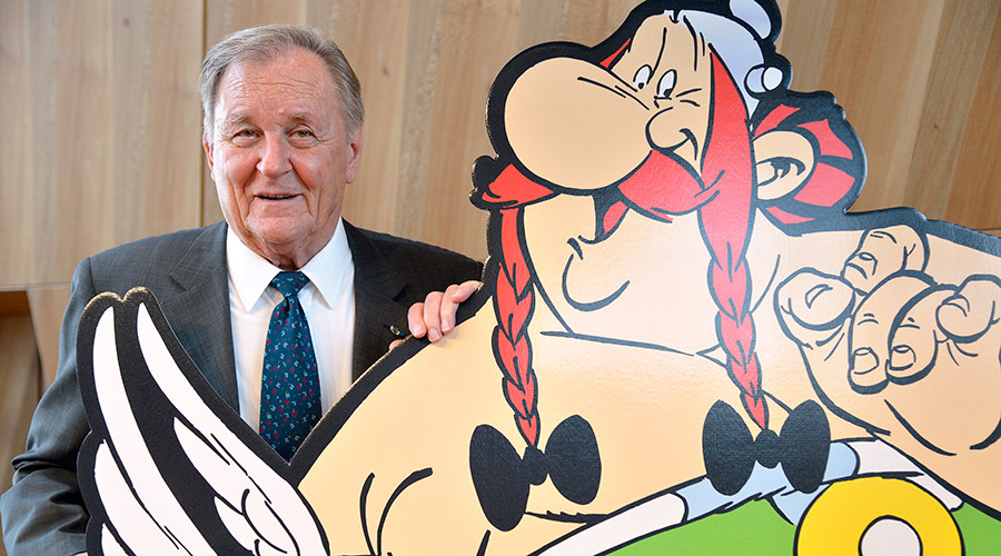French cartoonist and author Albert Uderzo poses beside a cardboard cut-out of Asterix and Obelix characters © Bertrand Guay