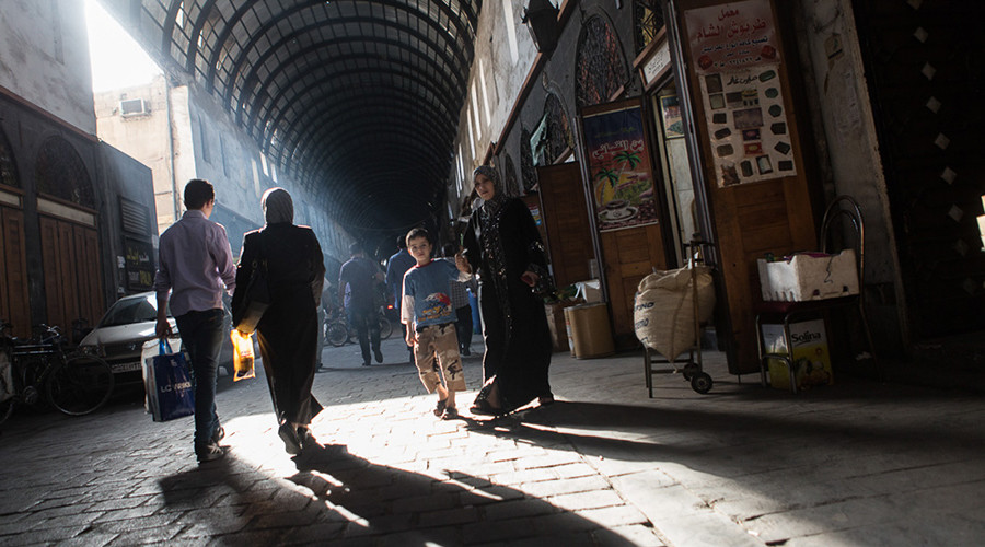 'We forgot what peace is': Everyday life in war-torn Damascus revealed in touching photo report