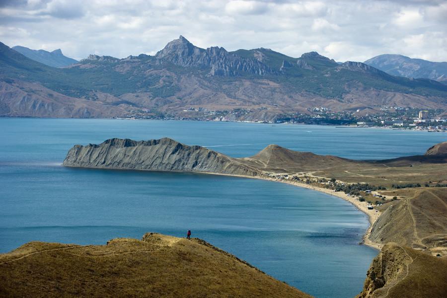Cape Chameleon and Koktebel town, background, in Crimea. © Sergey Malgavko