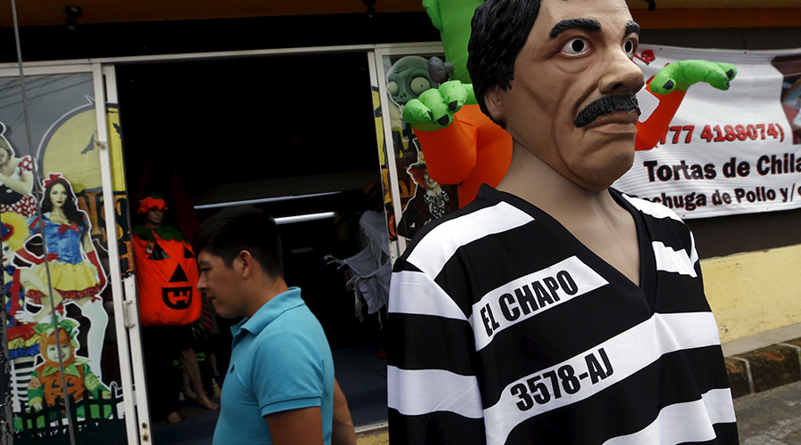 A man walks past a Guzman costume on display at the front of a shop, in the Mexican city of Cuernavaca near Mexico City October 14, 2015. © Henry Romero