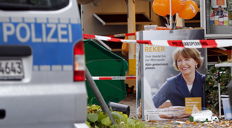 First aid equipment lies on the ground next to an election campaign poster of Henriette Reker in Cologne, Germany October 17, 2015. © Wolfgang Rattay