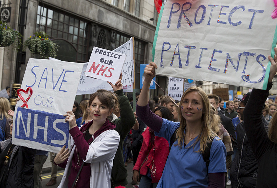 Protesters hold banners at a demonstration in support of junior doctors in London, Britain October 17, 2015 © Neil Hall