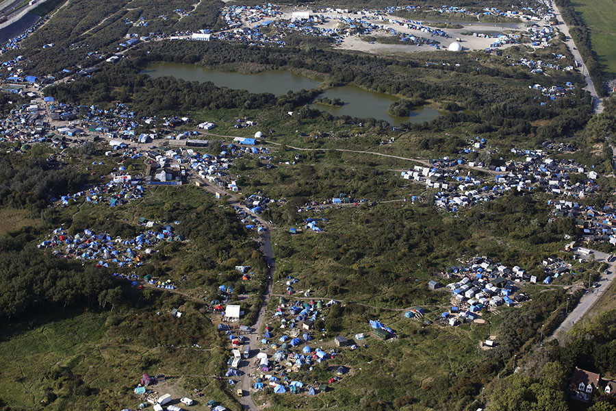 """An aerial view of a field called the """"New Jungle"""" with tents and makeshift shelters where migrants and asylum seekers stay, is seen in Calais, France, in this picture taken October 1, 2015. © Pascal Rossignol"""