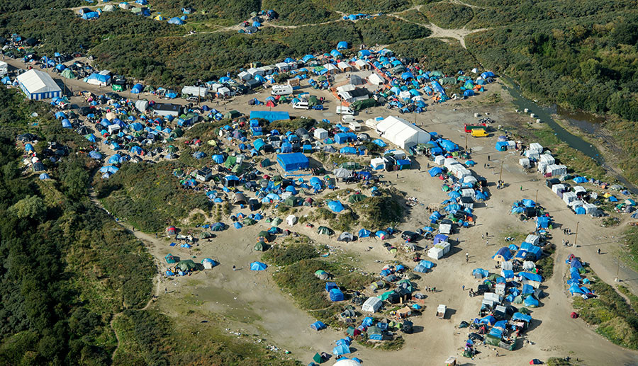 """An aerial picture taken in Calais on October 9, 2015 shows a site dubbed the """"New Jungle"""", where some 3,000 people have set up camp -- most seeking desperately to get to England. © Denis Charlet"""