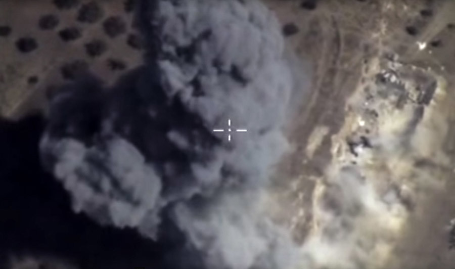 Russian Aerospace Force aircraft perform a pinpoint strike on an Islamic State fortified area with an underground bunker and a tunnel network, as well as a column of armored vehicles, in the Hama province, Syria. © Russian Defense Ministry