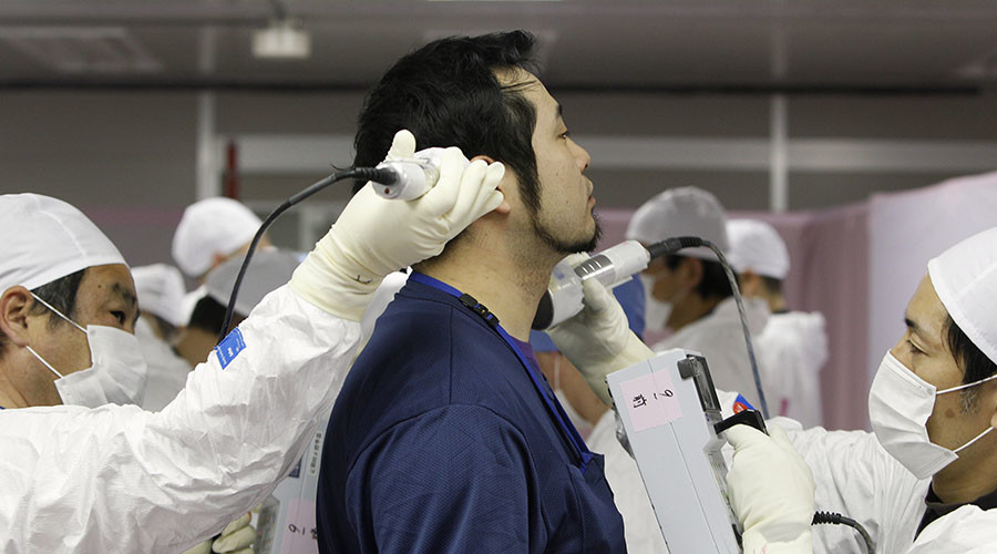 A worker screened for radiation as he enters the emergency operation center at Tokyo Electric Power Co. (TEPCO)'s tsunami-crippled Fukushima Daiichi nuclear power plant in Fukushima prefecture February 20, 2012. © Issei Kato