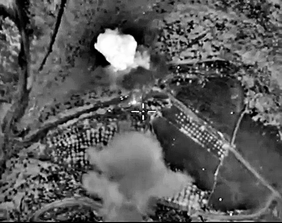 Russian military space forces drop bombs on militant bomb factories near Sermania, Idlib province. © Russian Defense Ministry