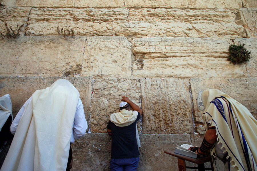 Jewish men pray at the Western Wall in Jerusalem's Old City © Ammar Awad