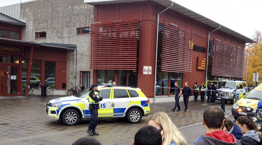 'Racial motive' behind masked man's knife attack at Swedish school that kills 2, injures 3