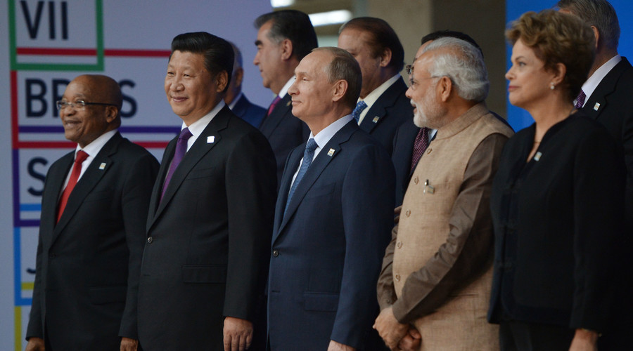 President of the Russian Federation Vladimir Putin, centre, during a group photograph of BRICS leaders and the leaders of the invited states. © Ramil Sitdikov