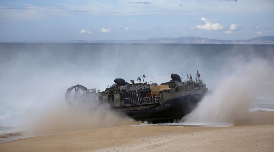 A NATO amphibious vehicle arrives to the seashore during a NATO military exercise at Raposa beach, near Setubal, Portugal. © Rafael Marchante
