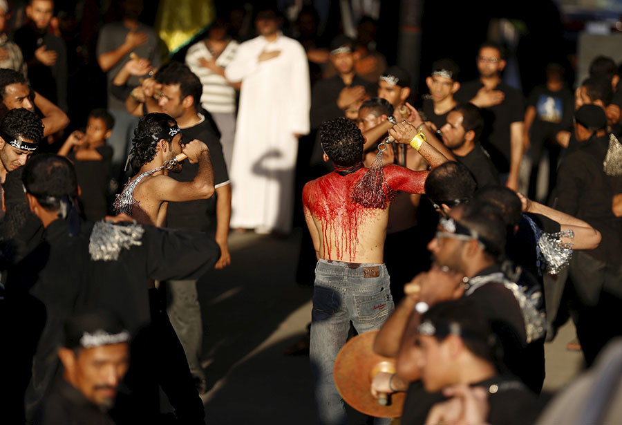 Saudi Shi'ite Muslims flagellate themselves with chains during an Ashura procession in Qatif, east Saudi Arabia, October 24, 2015. © Faisal Al Nasser