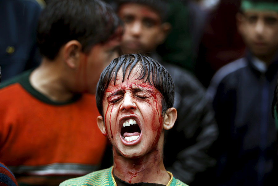 A Shi'ite Muslim boy shouts religious slogans after flagellating himself during a Muharram procession to mark Ashura in Srinagar, October 24, 2015. © Danish Ismail