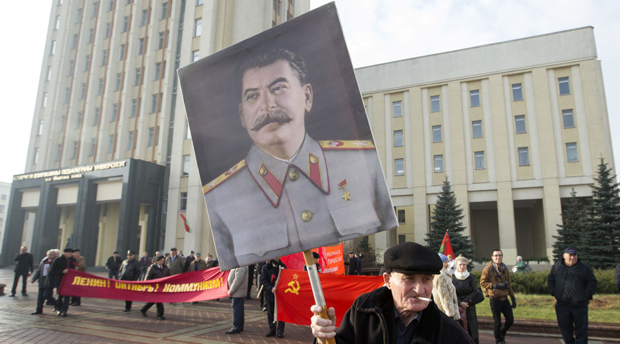 A man carries a portrait of Soviet leader Joseph Stalin at the Independence Square in Minsk November 7, 2014. © Vasily Fedosenko