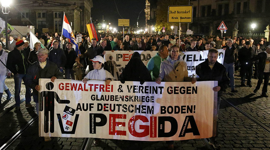 Supporters of the anti-immigration rightwing movement PEGIDA (Patriotic Europeans Against the Islamisation of the West) march during their weekly gathering in the historic part of Dresden, Germany October 26, 2015. © Fabrizio Bensch